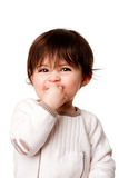 Cute mischievous baby toddler face. Face of a cute adorable baby infant toddler with innocent mischievous naughty expression, isolated Stock Photos