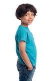 Cute Mixed Race Afro Caribbean Boy. Cute casual mixed race afro caribbean boy standing isolated in studio white background Stock Photos