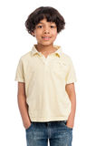 Cute Mixed Race Afro Caribbean Boy. Cute casual mixed race afro caribbean boy standing isolated in studio white background and yellow tee shirt Stock Images