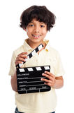 Cute Mixed Race Boy with Clapper Board. Mixed race boy smiing with film directors clapper board. Isolated on white background Stock Image