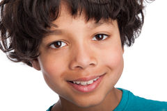 Cute Mixed Race Boy Close Up. Cute casual mixed race afro caribbean boy standing isolated in studio white background Royalty Free Stock Photo