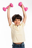 Cute MIxed Race Boy Lifting Weights Stock Images