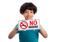 Cute Mixed Race Boy with No Smoking Sign. Royalty Free Stock Photography
