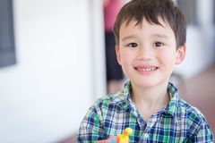 Cute Mixed Race Chinese and Caucasian Young Boy With Toy. Portrait of Mixed Race Chinese and Caucasian Young Boy With Toy Royalty Free Stock Photos