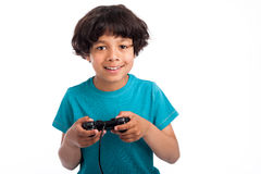 Cute Mixed Race Gamer. Cute mixed race kid with gaming console Stock Photo