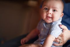 Free Cute Mixed Race Infant Having Fun With His Parents Stock Photos - 167352443
