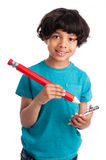 Cute Mixed Race Kid with Giant Pencil. Cute mixed race boy with giant pencil isolated on white background Royalty Free Stock Photo