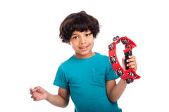 Cute Mixed Race Kid With Tambourine. Cute mixed race kid playing a tambourine, isolated against white background Royalty Free Stock Photo
