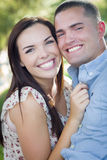 Cute Mixed Race Romantic Couple Portrait in the Park Stock Image