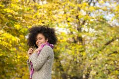 Cute mixed race woman smiling outdoors in nature Royalty Free Stock Images