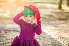 Cute Mixed Race Young Baby Girl Wearing Christmas Hat. Cute Mixed Race Young Baby Girl Having Fun Wearing Christmas Hat Outdoors stock images