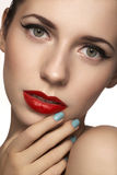 Cute model face with bright classical evening make-up, eyeliner on eyes, red lipstick Royalty Free Stock Photography