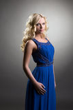 Cute model posing in dress for graduation ceremony Stock Image