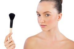 Cute model with powder brush. Looking at camera Royalty Free Stock Photo
