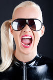 Cute model is screaming. Sexy blonde is wearing sunglasses and screaming Stock Photography