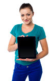 Cute model showing newly launched tablet pc Royalty Free Stock Photos