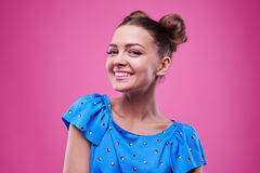 Cute model smiles broadly while looking at the camera Stock Images