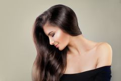 Cute Model Woman with Shiny Hairstyle and Makeup Stock Photography