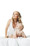 Cute mom with baby look at light Royalty Free Stock Photos
