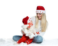 Cute mom and baby in santa hats Stock Photos
