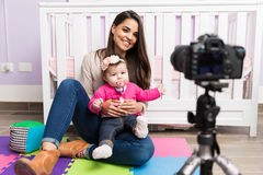 Cute mom doing parenting blog Royalty Free Stock Image