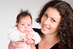 Cute mom with her baby Stock Photos