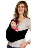 Cute Mom with her baby in a sling. Modern Mom with baby girl on white background Royalty Free Stock Image