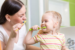 Cute mom teaching kid teeth brushing Royalty Free Stock Image
