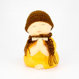 Cute monk ceramic statue isolated on white background Royalty Free Stock Image