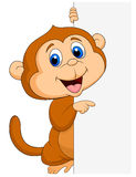 Cute monkey cartoon with blank sign Royalty Free Stock Photos