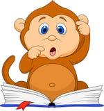 Cute monkey cartoon reading book Royalty Free Stock Image