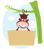 Cute Monkey hanging from tree with banner sign Royalty Free Stock Photo