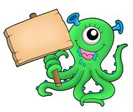 Cute monster with wooden sign Royalty Free Stock Photography