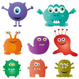 Cute monsters. Collection of different cute monsters, in cartoon style, isolated on white background Royalty Free Stock Images