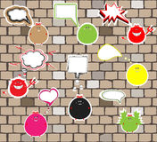 Cute monsters on a brick wall. vector Stock Image