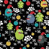 Cute monsters and Christmas seamless pattern. Stock Photography