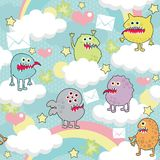 Cute monsters on clouds seamless texture. Royalty Free Stock Photos
