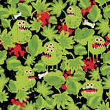 Cute monsters in the grass seamless pattern. Stock Photography