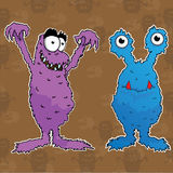 Cute monsters purple & blue Royalty Free Stock Image