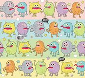 Cute monsters seamless background with stars. Royalty Free Stock Photos