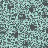 Cute monsters seamless texture on blue. Royalty Free Stock Image