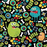 Cute monsters seamless texture. Stock Photography