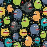 Cute monsters seamless texture with stars. Stock Photos