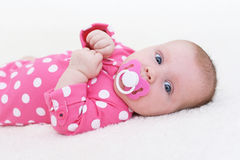 Cute 2 months baby girl  with dummy Royalty Free Stock Image