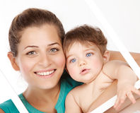 Cute mother with baby boy Stock Photo