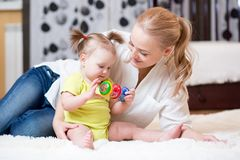 Mother and baby girl playing at home Royalty Free Stock Photos