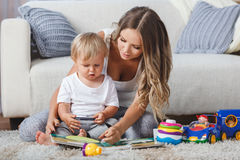 Cute mother and child boy play together indoors at home Stock Photo