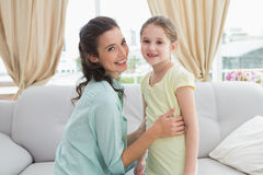 Cute mother and daughter on the couch Royalty Free Stock Photos