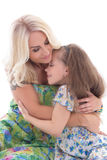 Cute mother and daughter hugging isolated on white Royalty Free Stock Photos