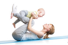 Cute mother having fun with her son doing yoga Royalty Free Stock Photos